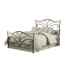 A charming addition to your master suite or guest room, this elegant metal bed features a scrolling headboard and footboard.  Produc...