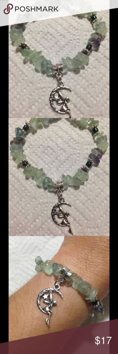 """Green Fluorite Fairy Bracelet This lovely bracelet is made with natural multicolored fluorite is shades of green and hints of purple. The fairy charm is silver tone.  This piece is elastic and will stretch to fit up to an 8"""" wrist. All PeaceFrog jewelry items are made by me! Take a look through my boutique for coordinating jewelry and more unique creations. PeaceFrog Jewelry Bracelets"""