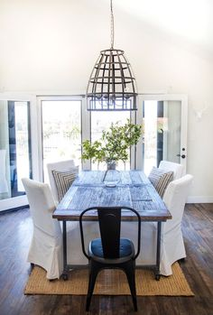 Restoration Hardware Table With IKEA Chairs And Bird Cage Pendant.