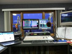 This is the view from the desk of modern disc jockey.With modern technology radio has been digitized. Computers are now used in radio production and even in listening to radio, as many stations offer online live broadcasts. Radio leaves behind the days of playing actual records, to simply selecting the track you want and pressing play with the click of a mouse.