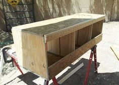 Here is a diy step by step process of building a Chicken Coop Nesting Box (Egg Laying Box). The size, variety and the location of a chicken nesting box will vary depending on your needs. Cheap Chicken Coops, Diy Chicken Coop Plans, Chicken Coop Designs, Backyard Chicken Coops, Building A Chicken Coop, Chickens Backyard, Types Of Chickens, Pet Chickens, Raising Chickens
