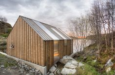 Built by TYIN tegnestue in , Norway with date 2011. Images by Pasi Aalto. Traditional Norwegian boat houses have been used to store boats and fishing gear,but now many of them are being conve...