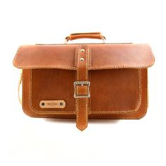Carry your camera in an attractive, durable,  all leather travel bag.  One main pocket to hold camera, lenses. and other large items. Two side pockets for small misc. cords or memory cards, and one small front pocket to carry charger, or guide books.The main body is made from vegetable tanned leather and the padding is made from 100% wool felt for softness.