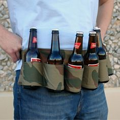 """Camo Six-Pack Beer Holster Belt Details:  Certified to bring on the good times and guaranteed to captivate the ladies, these beer belts eliminate any need for washboard abs (thank goodness!), since you'll already have a """"six pack""""...of delicious brews at your fingertips.  Haha, I know a few people who would love this!"""
