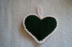 Green crochet heart ornament with white trim by CreativeCrochetbyChris, $5.00 USD  SOLD