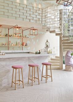 Beautiful Bright Kitchen with Blush Pink High Top Stools and Copper Light Fixtures
