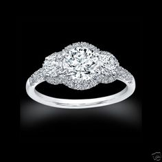 3 STONE DIAMOND ENGAGEMENT RING 2 CT$14,000... Pretty, it looks like my ring but with two stones, I want the 2 added