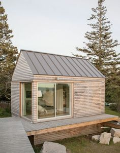 trio of tiny cabins forms a seasonal vacation retreat in an old quarry. One cabin is the living/dining/kitchen pavilion, the other two are sleeping cabins. Tiny Cabins, Tiny House Cabin, Modern Cabins, Small Prefab Cottages, Prefab Tiny Houses, Small Modern Cabin, Prefab Cabins, Cob Houses, Lake Houses