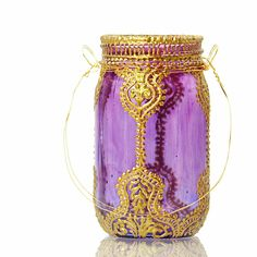 Hand Painted Mason Jar Lantern Violet Glass with Gold by LITdecor. $24.00, via Etsy. Usually mason jar crafts make me a little meh.. But this is lovely/gaudy.