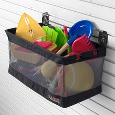 for Managing Kid Gear Put outside toys in a mesh or washable bin so sandbox toys, and pool toys can be hosed down for easy clean up.Put outside toys in a mesh or washable bin so sandbox toys, and pool toys can be hosed down for easy clean up. Outdoor Toy Storage, Pool Storage, Kid Toy Storage, Outdoor Toys, Garage Storage, Outdoor Play, Daycare Storage, Storage Bins, Kitchen Storage