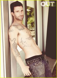 He makes tattoos sexy!  I can honestly say Adam you are one of the hotest white men around...YUMMMM.
