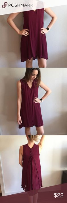 Maroon Dress with Cutout Details Any Texas Aggie fans out there? This is the PERFECT Maroon game day dress (for any maroon colored school really). Great quality and only worn once. Cute peek-a-boo cut outs on the shoulders, a lace up back, and a flattering high-low hemline. Dresses High Low