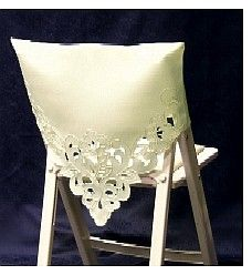 I see this done with a sheer fabric and lace.   It would fit over the white chair covers.  different ways to tie a chair sash for a wedding | Folding Chairs | Toledo Wedding Planner | Perrysburg Wedding ...