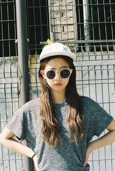 baseball cap + shades + grey shirt : airport wear: Asian