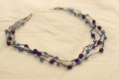 """the infamous super simple crocheted bead necklace"" tutorial. Can be done with wire, metallic thread such as sulky, or stainless steel or copper habu yarns. More than a hundred variations on ravelry at http://www.ravelry.com/patterns/library/infamous-beaded-necklaces-tutorial/people"