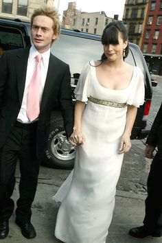 Actress Liv Tyler commissioned Alexander McQueen to make the gown for her wedding to British rocker Royston Langdon, though they had already wed in Barbados, they held a reception at NY's Pastis restaurant, packed with rock & roll royalty, inc. Steve Tyler, Todd Rundgren, David Bowie, Iman, Kate Hudson & then hus. Chris Robinson.