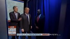 Dr. Ben Carson awkwardly waited in the wings after he was introduced at ABC News' Republican presidential debate Saturday and stood in the way of the other GOP candidates as their names were called.