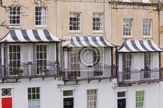 Wall Mural Striped canopies of Georgian house balconies in Bristol UK
