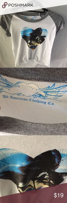 All American clothing co tee shirt This tee shirt is in excellent condition.  It has a little tie at the bottom of the shirt all american clothing co Tops Tees - Short Sleeve