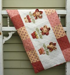 Quilted Flower Pot Pillow Sham but would make great table runner