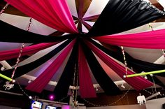 black & hot pink ceiling draping