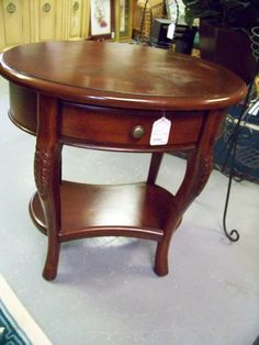 SOLD. Oval end table. www.chconsignment.com