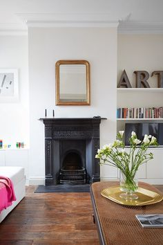 See all our stylish living room design ideas on HOUSE by House & Garden, including this sitting room in a London flat designed by Harriet Anstruther, which features a black chimneypiece and white modern furniture.