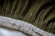 "I have thought about something like this for holding the pleats of my Italian dresses...  (Viking pants, made entirely with hand sewn stitches. Wool + linen lining.  ""Vrangtante Brun"")"