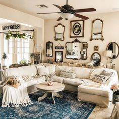 The antique mirrors and photo frames have made this gallery wall absolutely PERFECT and has created the focal point of her french country home! We also LOVE how gorgeous our Love You More Blanket looks in this space! French Country Wall Decor, French Country Living Room, French Country Farmhouse, Farmhouse Wall Decor, French Country Decorating, French Decor, Antique Wall Decor, Antique Mirrors, Mirror Gallery Wall