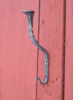 Hand forged hook for coat and hat, blacksmith made railroad spike wall hook on Etsy, $30.00