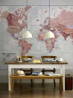 World maps are relatively inexpensive and can add so much to a blank wall.