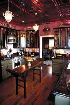 Wow! I love the ceiling, the floor, the green with gold trim cabinets, and the hanging lights!