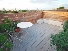 Battersea Roof - Really Nice Gardens.  The bespoke storage benches deliver an area for seating friends or for lounging, as well as plenty of space to hide away extra chairs, BBQ or gardening tools.