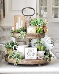 We do love a beautifully styled tiered tray, and this one sure is pretty! The su… We do love a beautifully styled tiered tray, and this one sure is pretty! The succulents add a lovely pop of fresh attitude to our Distressed Tiered Tray too! Diy Home Decor, Room Decor, Decor Crafts, Wall Decor, Tray Styling, Styling Tips, Tiered Stand, Deco Floral, Tray Decor