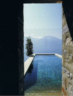 Steps leading down into that beautiful pool and look at that mountainous outlook!