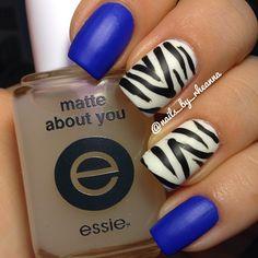 Blue polish & Zebra print nail art combination @nails_by_rheanna