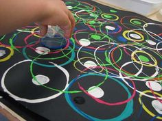 Circle Printing (cups, lids, jars dipped in paint). Awesome project to do with Elle