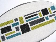 Contemporary cross-stitch items.  LOVE.