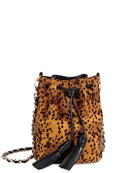 Behold the bucket bag that makes the biggest and boldest statement! JF Roar by JustFab pulls tight for an easy close and holds everything!