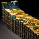 Another landscape carved out of books creating a surreal landscape.