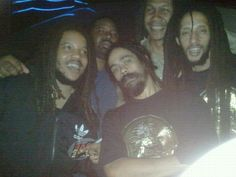 5 men. Three Marleys: Stephen, Damian and Julian.  I still wonder if it is humanly possible for them to ever take a bad photo. :)