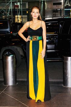 Blake Lively wears a black camisole with belted Balmain striped trousers