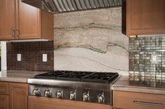 San Mateo, CA: New cooktop with granite backsplash. Valley Home Builders