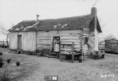 "Slave Quarters, ""The Oaks Plantation,"" Colbert County, Alabama. The original log cabin is said to have been built in the 1700's by Native Americans and is located nine miles south east of Tuscumbia, near Spring Valley. (Alex Bush photographer)   March 28, 1935."