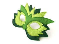 Green dragon mask for children for Halloween, Carnival, school plays or just for fun!  All children like to play dressing up. Some of them so much that they don´t want to take the mask off, even when eating! But it is not a problem with this mask! It sits comfortably on the childs nose without getting in the way, making breathing and eating easy. I hand cut the felt and machine stitched the mask. There is an extra felt backing to make it sturdy and long lasting. The elastic is triple…