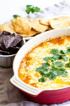 Bean Dip - Need a tasty appetizer in less than 30 minutes to feed a crowd? This bean dip is your answer! Cheesy and filling dip with ton of flavor without much effort. Yummy Appetizers, Appetizer Recipes, Snack Recipes, Vegetarian Appetizers, Vegan Recipes, Game Day Snacks, Game Day Food, Layered Bean Dip, Bruschetta Toppings