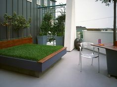 An outdoor daybed is possible even in the city. If you're an urban dweller looking for cushioned grass for your afternoon naps or picnics, this grass-filled daybed might just be perfect. Design by Pamela Berstler