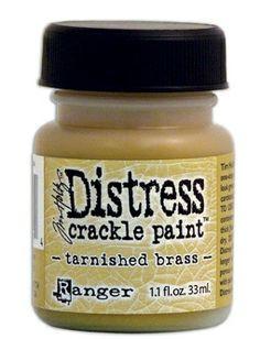 RANGER: TIM HOLTZ - DISTRESS CRACKLE PAINT - TARNISHED BRASS Distress Crackle Paint er en maling som lager en eldet effekt - krakelering.   http://www.kreativscrapping.no/categories/tim-holtz-distress-crackle-paint