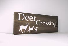 Rustic deer crossing sign, complete with deer family.