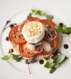 Shallot and baby plum tomato tart-tatin served with goats cheese fondant and dressed garden leaves.  ©Pickled Walnut Bespoke Catering